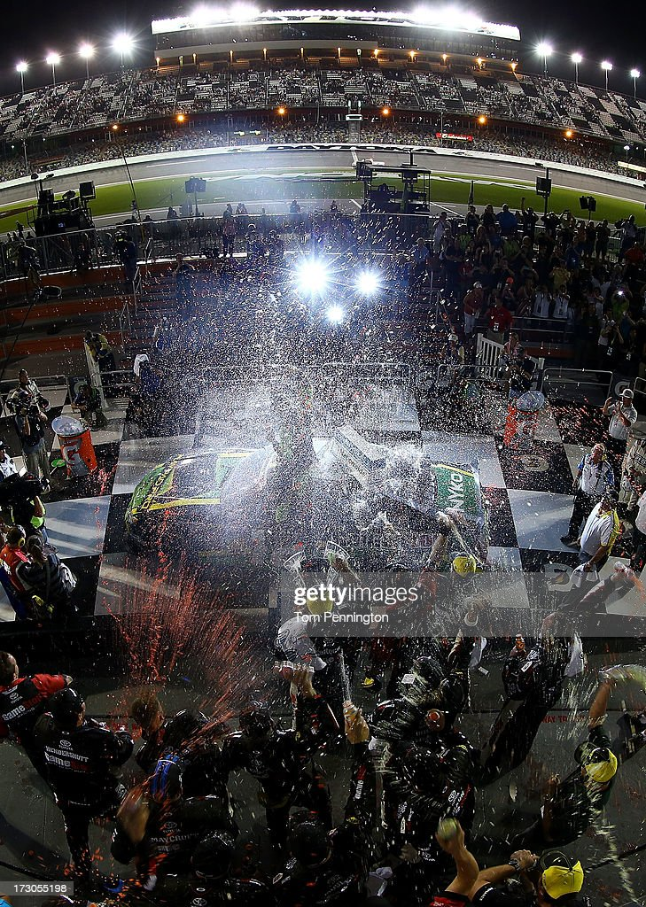 Matt Kenseth driver of the GameStop Toyota celebrates with his crew in victory lane after he won the NASCAR Nationwide Series Subway Firecracker 250...