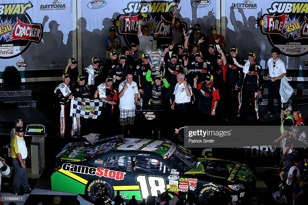 Matt Kenseth driver of the GameStop Toyota celebrates with the trophy and his crew in victory lane after winning the NASCAR Nationwide Series Subway...