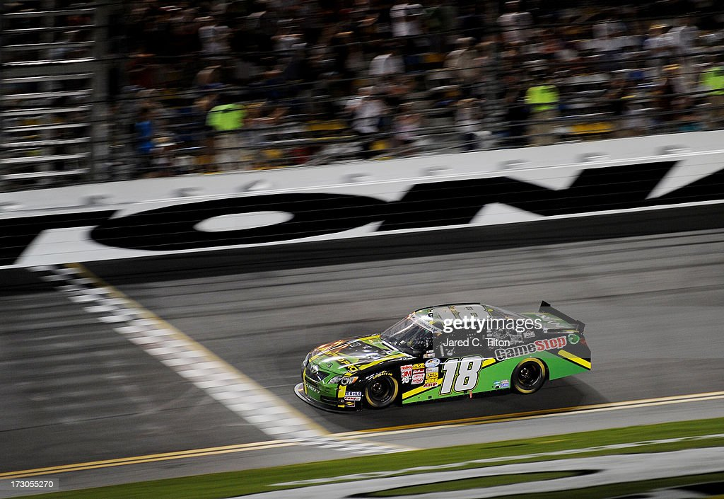 Matt Kenseth driver of the GameStop Toyota crosses the finish to win the NASCAR Nationwide Series Subway Firecracker 250 at Daytona International...