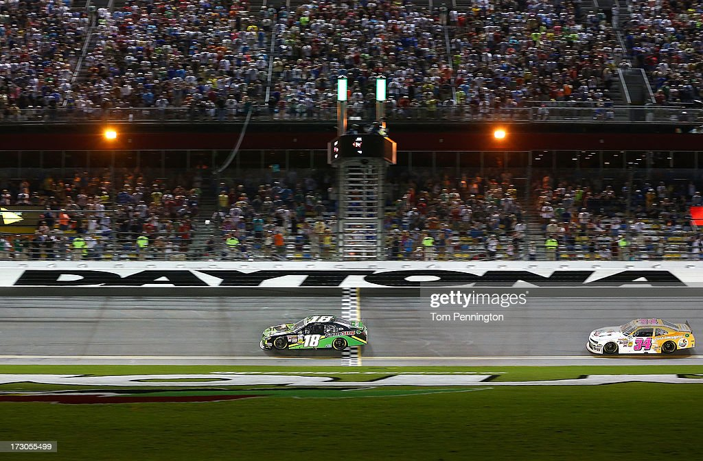 Matt Kenseth, driver of the #18 GameStop Toyota , crosses the start finish line to take the Sunoco checkered flag and win the NASCAR Nationwide Series Subway Firecracker 250 at Daytona International Speedway on July 5, 2013 in Daytona Beach, Florida.