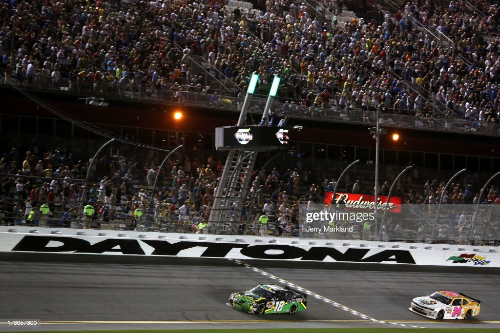 Matt Kenseth, driver of the #18 GameStop Toyota, crosses the start finish line to take th checkered flag and win the NASCAR Nationwide Series Subway Firecracker 250 at Daytona International Speedway on July 5, 2013 in Daytona Beach, Florida.