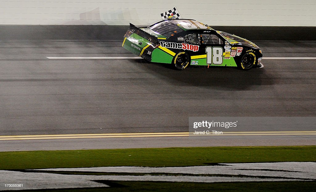 Matt Kenseth, driver of the #18 GameStop Toyota , drives with the checkered flag after winning the NASCAR Nationwide Series Subway Firecracker 250 at Daytona International Speedway on July 5, 2013 in Daytona Beach, Florida.