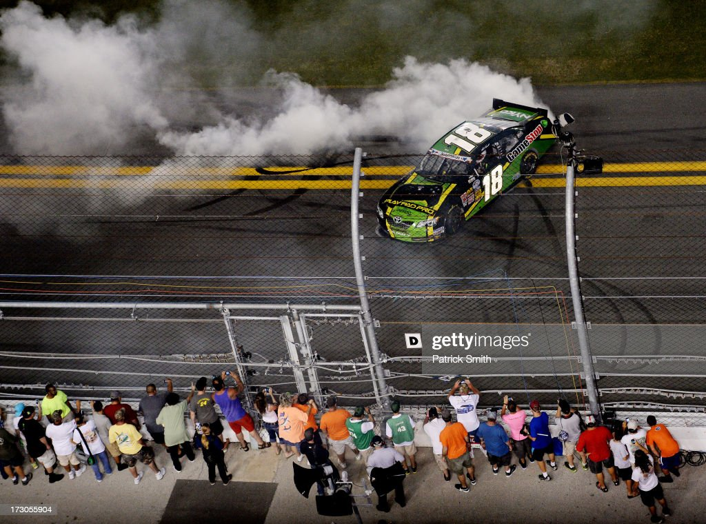 Matt Kenseth driver of the GameStop Toyota performs a burnout after winning the NASCAR Nationwide Series Subway Firecracker 250 at Daytona...