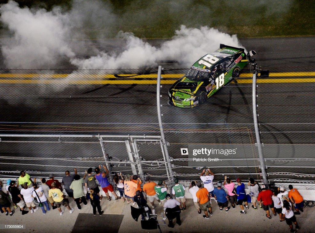 Matt Kenseth, driver of the #18 GameStop Toyota, performs a burnout after winning the NASCAR Nationwide Series Subway Firecracker 250 at Daytona International Speedway on July 5, 2013 in Daytona Beach, Florida.