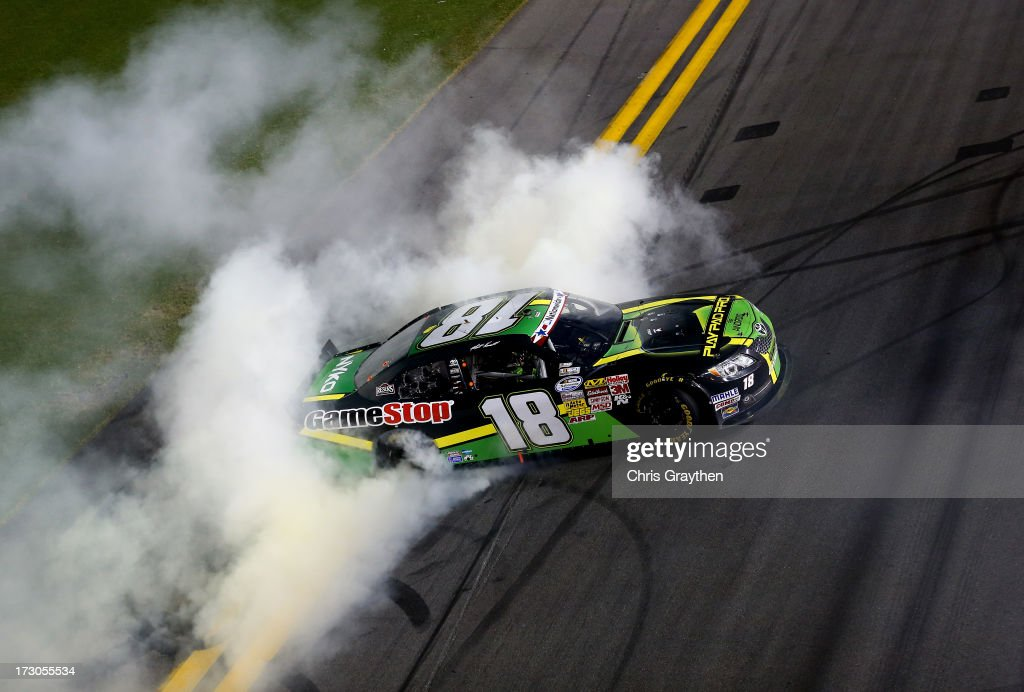 Matt Kenseth, driver of the #18 GameStop Toyota, performs a burnout in celebration of winning the NASCAR Nationwide Series Subway Firecracker 250 at Daytona International Speedway on July 5, 2013 in Daytona Beach, Florida.