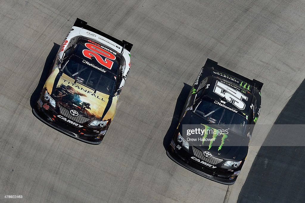 Matt Kenseth, driver of the #20 GameStop Toyota, races Kyle Busch, driver of the #54 Monster Energy Toyota, during the NASCAR Nationwide Series Drive To Stop Diabetes 300 at Bristol Motor Speedway on March 15, 2014 in Bristol, Tennessee.