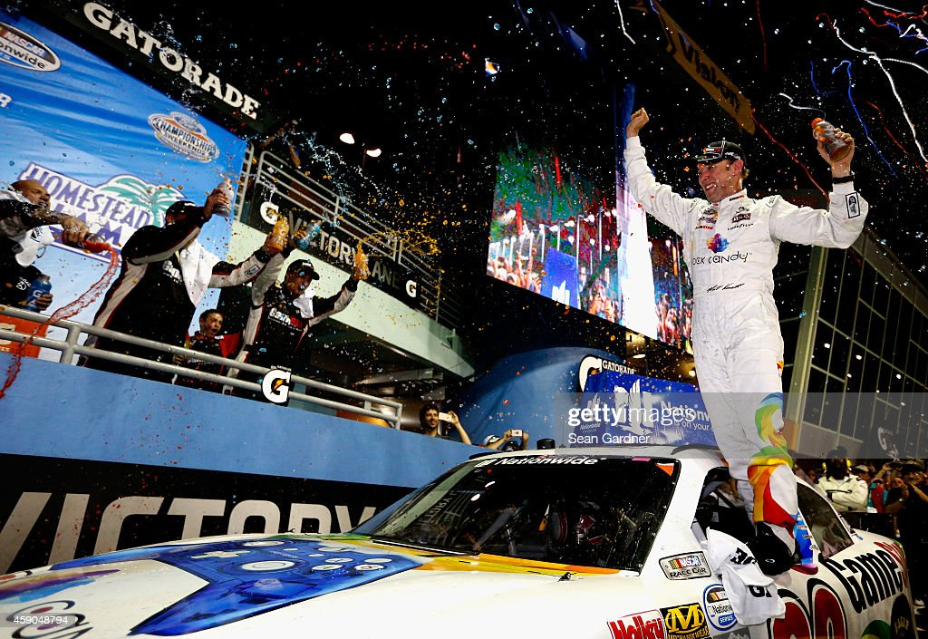Matt Kenseth driver of the GameStop/Rock Candy Toyota celebrates in victory lane after winning the NASCAR Nationwide Series Ford EcoBoost 300 at...