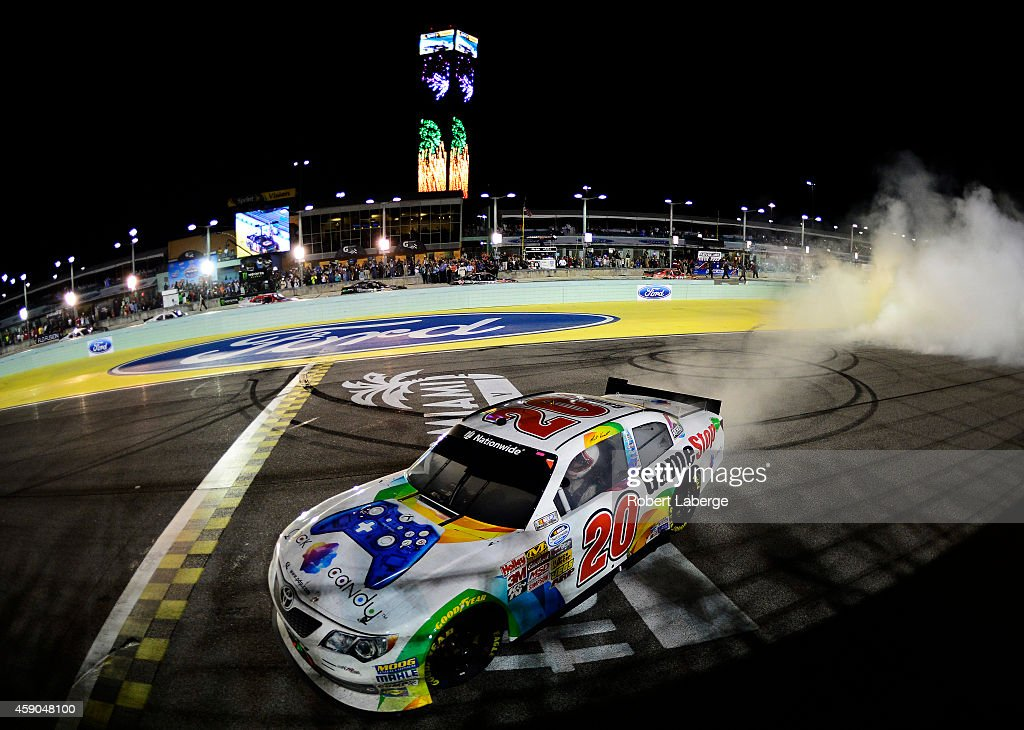 Matt Kenseth driver of the GameStop/Rock Candy Toyota celebrates with a burnout after winning the NASCAR Nationwide Series Ford EcoBoost 300 at...