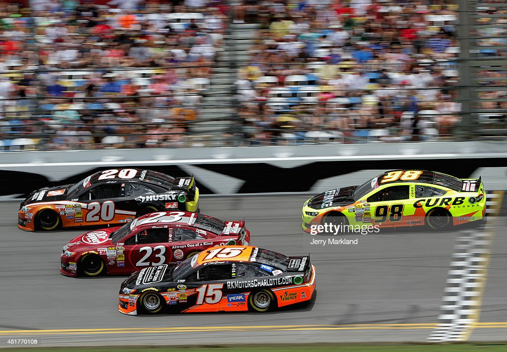 Matt Kenseth, driver of the #20 Home Depot Husky Toyota, leads Alex Bowman, driver of the #23 Dr. Pepper Toyota, Clint Bowyer, driver of the #15 RK Motors Charlotte Toyota, and Josh Wise, driver of the #98 Charlie Crist For Florida Ford, during the NASCAR Sprint Cup Series Coke Zero 400 at Daytona International Speedway on July 6, 2014 in Daytona Beach, Florida.