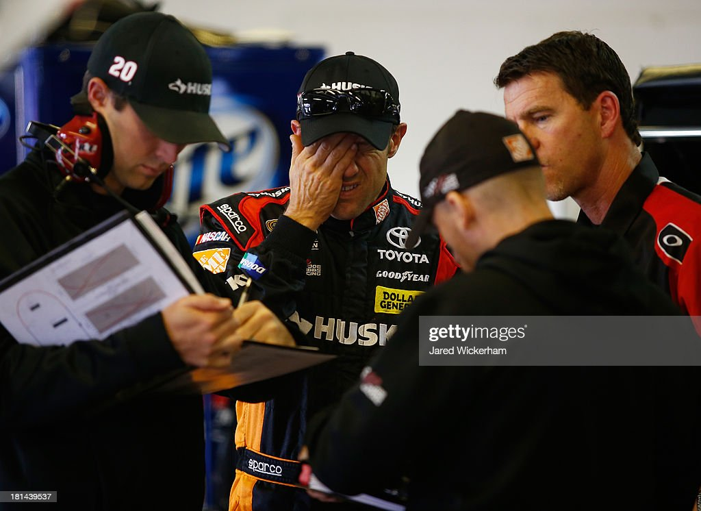 <a gi-track='captionPersonalityLinkClicked' href=/galleries/search?phrase=Matt+Kenseth&family=editorial&specificpeople=204192 ng-click='$event.stopPropagation()'>Matt Kenseth</a>, driver of the #20 Home Depot / Husky Toyota, stands inside the garage during practice for the NASCAR Sprint Cup Series Sylvania 300 at New Hampshire Motor Speedway on September 21, 2013 in Loudon, New Hampshire.