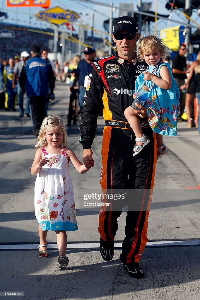 Matt Kenseth, driver of the #20 Home Depot / Husky Toyota, walks the grid with his daughters Kaylin (L) and Grace (R) during the NASCAR Sprint Cup Series Coke Zero 400 at Daytona International Speedway on July 6, 2013 in Daytona Beach, Florida.