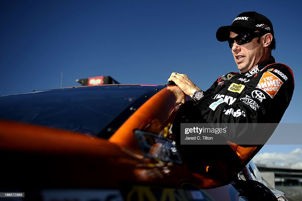 Matt Kenseth, driver of the #20 Home Depot 'Let's Do This' Toyota, climbs from his car after qualifying for the NASCAR Sprint Cup Series AAA Texas 500 at Texas Motor Speedway on November 1, 2013 in Fort Worth, Texas.