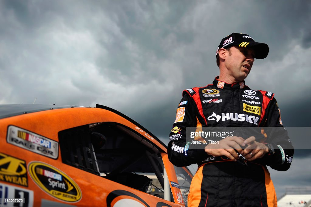 Matt Kenseth, driver of the #20 Home Depot 'Let's Do This' Toyota, climbs out of his car after qualifying for the NASCAR Sprint Cup Series AAA 400 at Dover International Speedway on September 27, 2013 in Dover, Delaware.