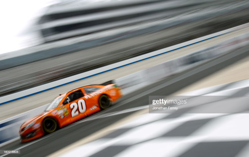 Matt Kenseth, driver of the #20 Home Depot 'Let's Do This' Toyota, drives down pit lane during practice for the NASCAR Sprint Cup Series AAA 400 at Dover International Speedway on September 27, 2013 in Dover, Delaware.