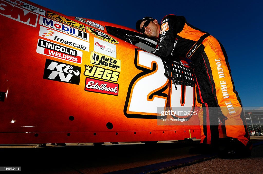 Matt Kenseth, driver of the #20 Home Depot 'Let's Do This' Toyota, gets in his car during qualifying for the NASCAR Sprint Cup Series AAA Texas 500 at Texas Motor Speedway on November 1, 2013 in Fort Worth, Texas.