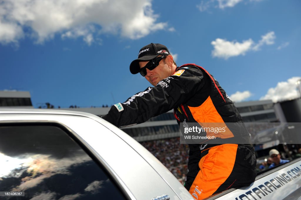 Matt Kenseth, driver of the #20 Home Depot 'Let's Do This' Toyota, participates in pre-race ceremonies for the NASCAR Sprint Cup Series AAA 400 at Dover International Speedway on September 29, 2013 in Dover, Delaware.