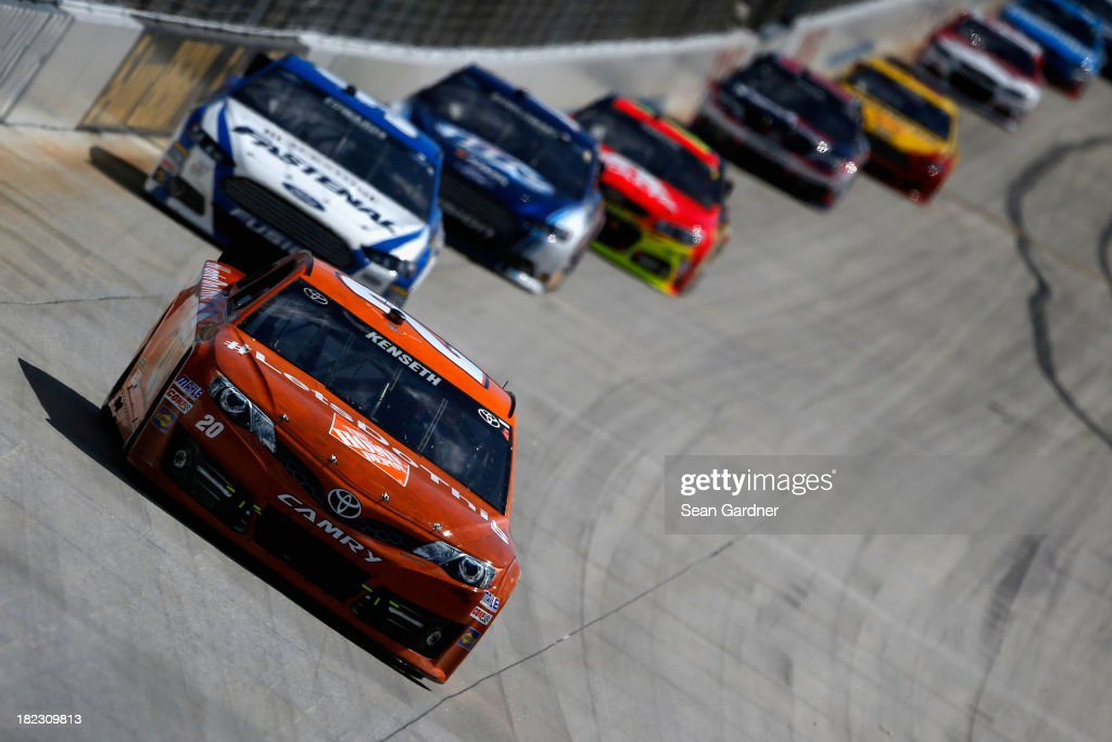 Matt Kenseth, driver of the #20 Home Depot 'Let's Do This' Toyota, leads a group of cars during the NASCAR Sprint Cup Series AAA 400 at Dover International Speedway on September 29, 2013 in Dover, Delaware.