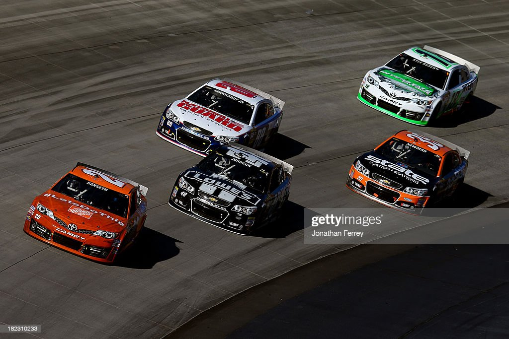 Matt Kenseth, driver of the #20 Home Depot 'Let's Do This' Toyota, leads a pack of cars during the NASCAR Sprint Cup Series AAA 400 at Dover International Speedway on September 29, 2013 in Dover, Delaware.