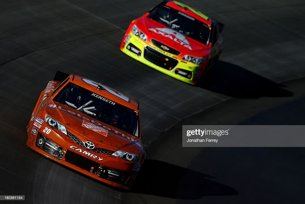 Matt Kenseth, driver of the #20 Home Depot 'Let's Do This' Toyota, leads Jeff Gordon, driver of the #24 Axalta Chevrolet, during the NASCAR Sprint Cup Series AAA 400 at Dover International Speedway on September 29, 2013 in Dover, Delaware.