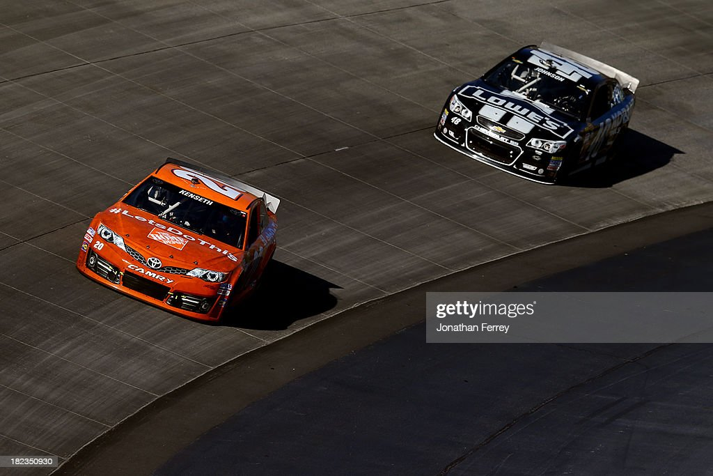 Matt Kenseth, driver of the #20 Home Depot 'Let's Do This' Toyota, leads Jimmie Johnson, driver of the #48 Lowe's / Kobalt Tools Chevrolet, during the NASCAR Sprint Cup Series AAA 400 at Dover International Speedway on September 29, 2013 in Dover, Delaware.