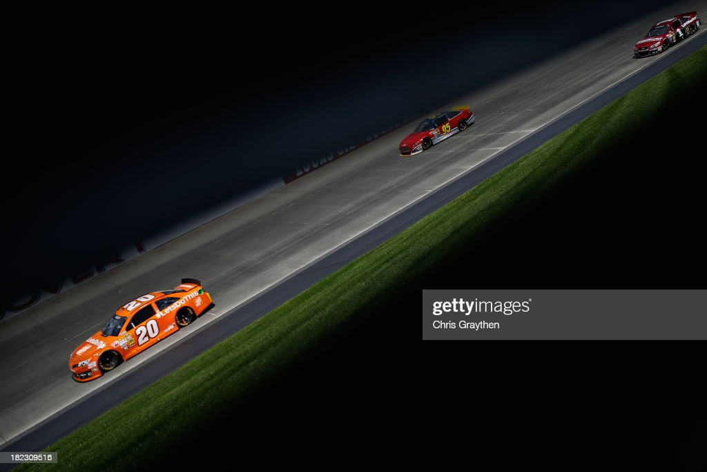 Matt Kenseth, driver of the #20 Home Depot 'Let's Do This' Toyota, leads Reed Sorenson, driver of the #95 Leavine Family Racing Ford, and Jamie McMurray, driver of the #1 LiftMaster Chevrolet, during the NASCAR Sprint Cup Series AAA 400 at Dover International Speedway on September 29, 2013 in Dover, Delaware.