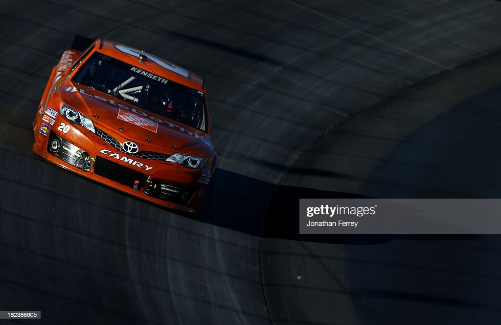 Matt Kenseth, driver of the #20 Home Depot 'Let's Do This' Toyota, races the NASCAR Sprint Cup Series AAA 400 at Dover International Speedway on September 29, 2013 in Dover, Delaware.