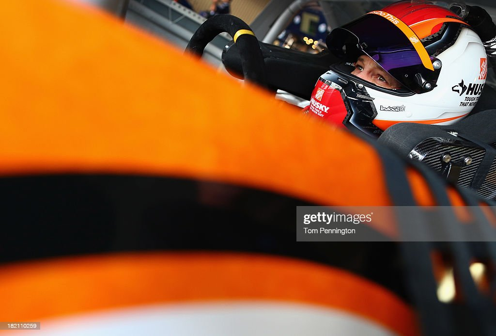 Matt Kenseth, driver of the #20 Home Depot 'Let's Do This' Toyota, sits in his car in the garage area during practice for the NASCAR Sprint Cup Series AAA 400 at Dover International Speedway on September 28, 2013 in Dover, Delaware.