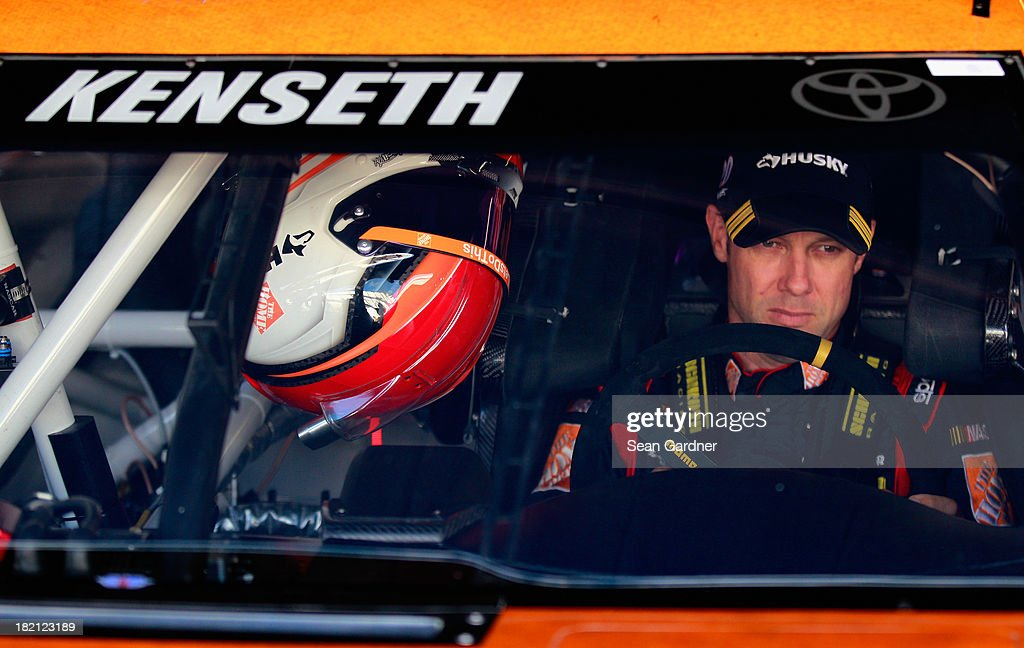 Matt Kenseth, driver of the #20 Home Depot 'Let's Do This' Toyota, sits in his car during practice for the NASCAR Sprint Cup Series AAA 400 at Dover International Speedway on September 28, 2013 in Dover, Delaware.