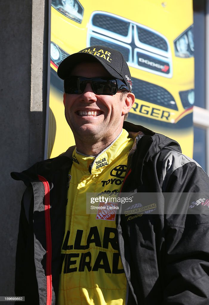 Matt Kenseth, driver of the #20 Joe Gibbs Racing Toyota, watches on from the garage area during NASCAR Testing at Charlotte Motor Speedway on January 18, 2013 in Charlotte, North Carolina.