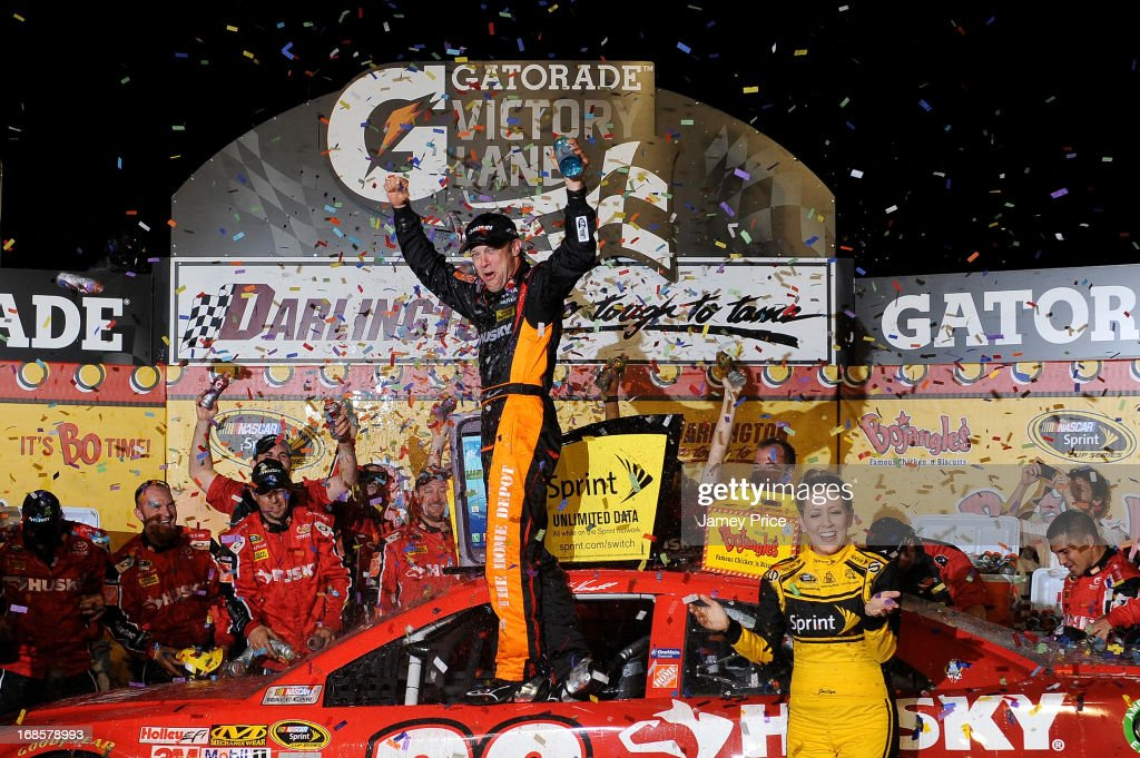 Matt Kenseth, driver of the #20 The Home Depot / Husky Toyota, celebrates with his crew in victory lane after winning the NASCAR Sprint Cup Series Bojangles' Southern 500 at Darlington Raceway on May 11, 2013 in Darlington, South Carolina.