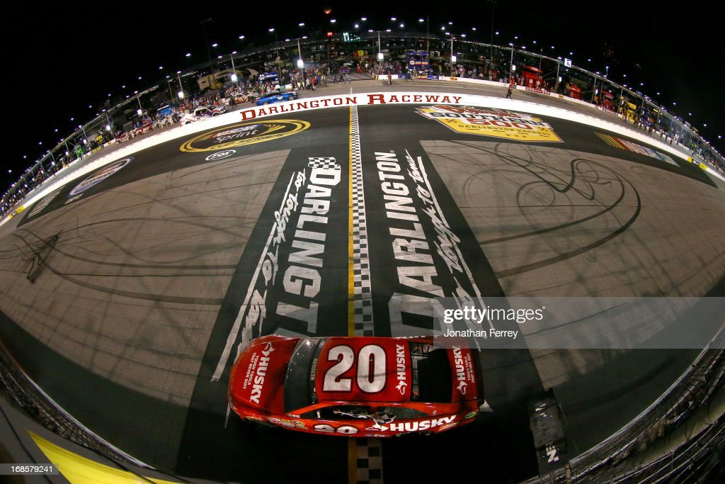 Matt Kenseth, driver of the #20 The Home Depot / Husky Toyota, celebrates with the checkered flag after winning during the NASCAR Sprint Cup Series Bojangles' Southern 500 at Darlington Raceway on May 11, 2013 in Darlington, South Carolina.