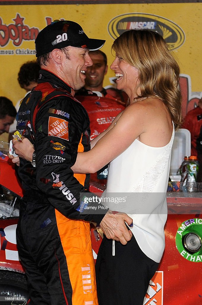 Matt Kenseth, driver of the #20 The Home Depot / Husky Toyota, celebrates with his wife Katie in victory lane after winning the NASCAR Sprint Cup Series Bojangles' Southern 500 at Darlington Raceway on May 11, 2013 in Darlington, South Carolina.