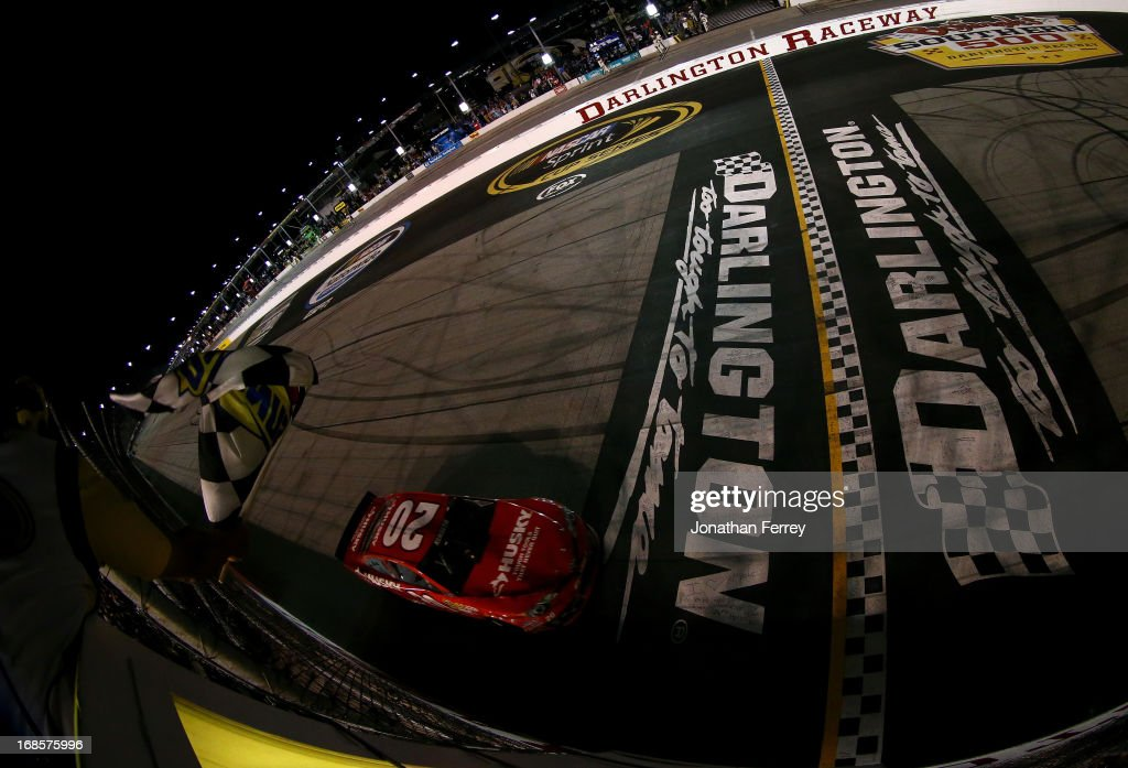 Matt Kenseth, driver of the #20 The Home Depot / Husky Toyota, crosses the star/finish line to take the checkered flag and win the NASCAR Sprint Cup Series Bojangles' Southern 500 at Darlington Raceway on May 11, 2013 in Darlington, South Carolina.