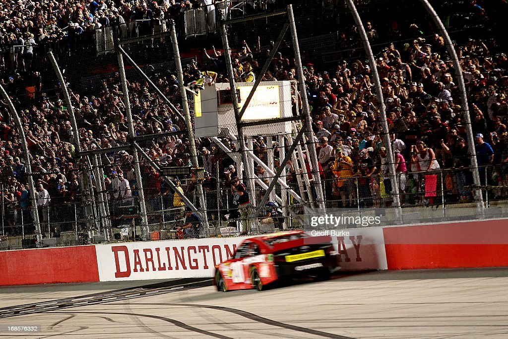Matt Kenseth, driver of the #20 The Home Depot / Husky Toyota, crosses the start/finish line to take the checkered flag and win during the NASCAR Sprint Cup Series Bojangles' Southern 500 at Darlington Raceway on May 11, 2013 in Darlington, South Carolina.