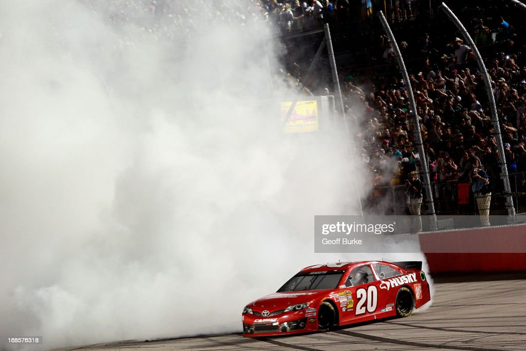 Matt Kenseth, driver of the #20 The Home Depot / Husky Toyota, performs a burnout in celebration of winning the NASCAR Sprint Cup Series Bojangles' Southern 500 at Darlington Raceway on May 11, 2013 in Darlington, South Carolina.