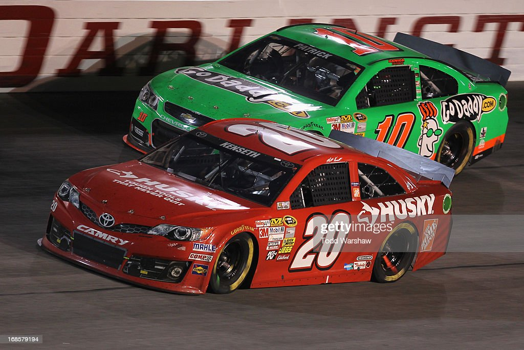 Matt Kenseth, driver of the #20 The Home Depot / Husky Toyota, races Danica Patrick, driver of the #10 GoDaddy.com Chevrolet, during the NASCAR Sprint Cup Series Bojangles' Southern 500 at Darlington Raceway on May 11, 2013 in Darlington, South Carolina.