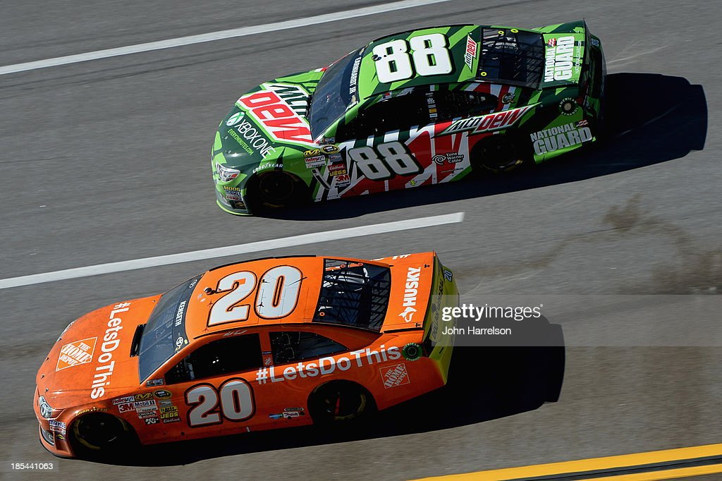 Matt Kenseth, driver of the #20 The Home Depot Toyota, and Dale Earnhardt Jr., driver of the #88 Mountain Dew / XBox One Chevrolet, race during the NASCAR Sprint Cup Series Camping World RV Sales 500 at Talladega Superspeedway on October 20, 2013 in Talladega, Alabama.