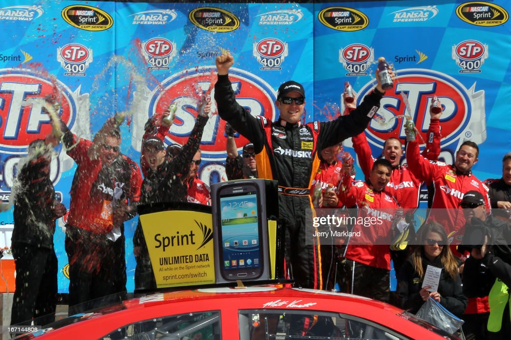 Matt Kenseth, driver of the #20 The Home Depot/Husky Toyota, celebrates in Victory Lane after winning the NASCAR Sprint Cup Series STP 400 at Kansas Speedway on April 21, 2013 in Kansas City, Kansas.