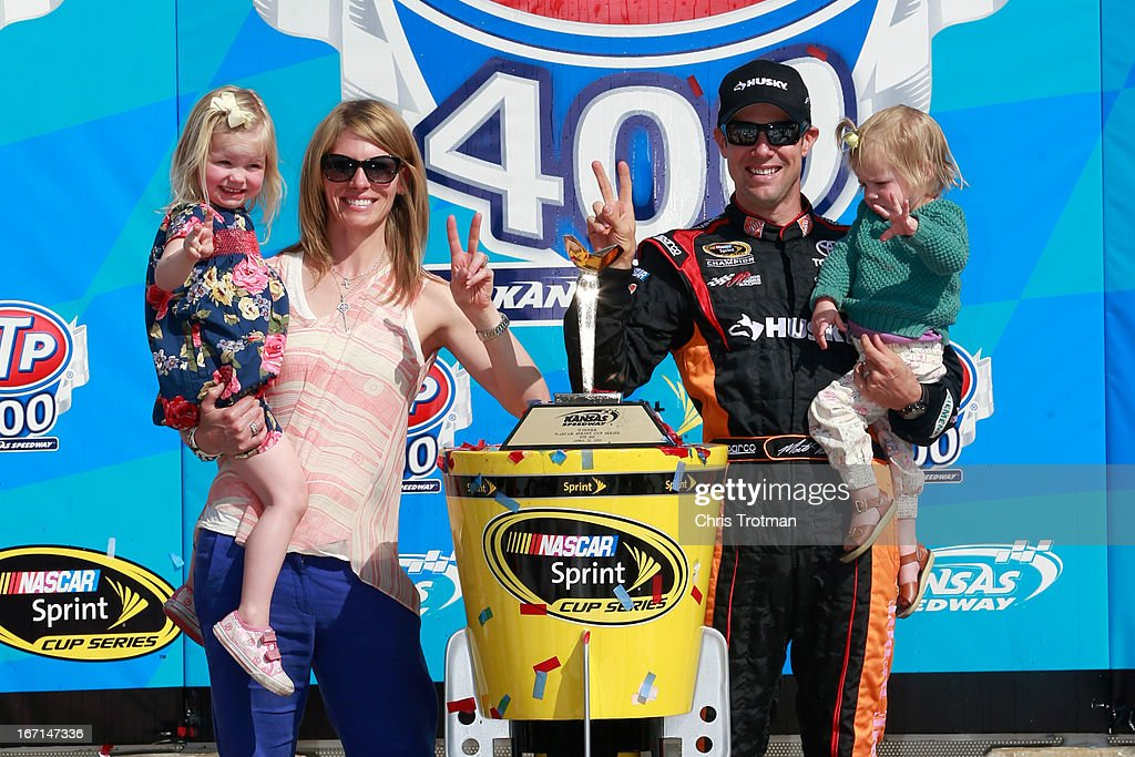 Matt Kenseth, driver of the #20 The Home Depot/Husky Toyota, celebrates in Victory Lane with his wife Katie children Kaylin and Grace after he won the NASCAR Sprint Cup Series STP 400 at Kansas Speedway on April 21, 2013 in Kansas City, Kansas.