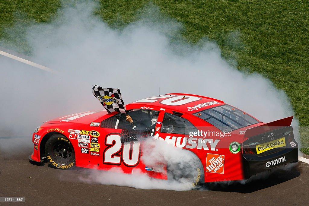 Matt Kenseth, driver of the #20 The Home Depot/Husky Toyota, celebrates with a burnout after winning the NASCAR Sprint Cup Series STP 400 at Kansas Speedway on April 21, 2013 in Kansas City, Kansas.