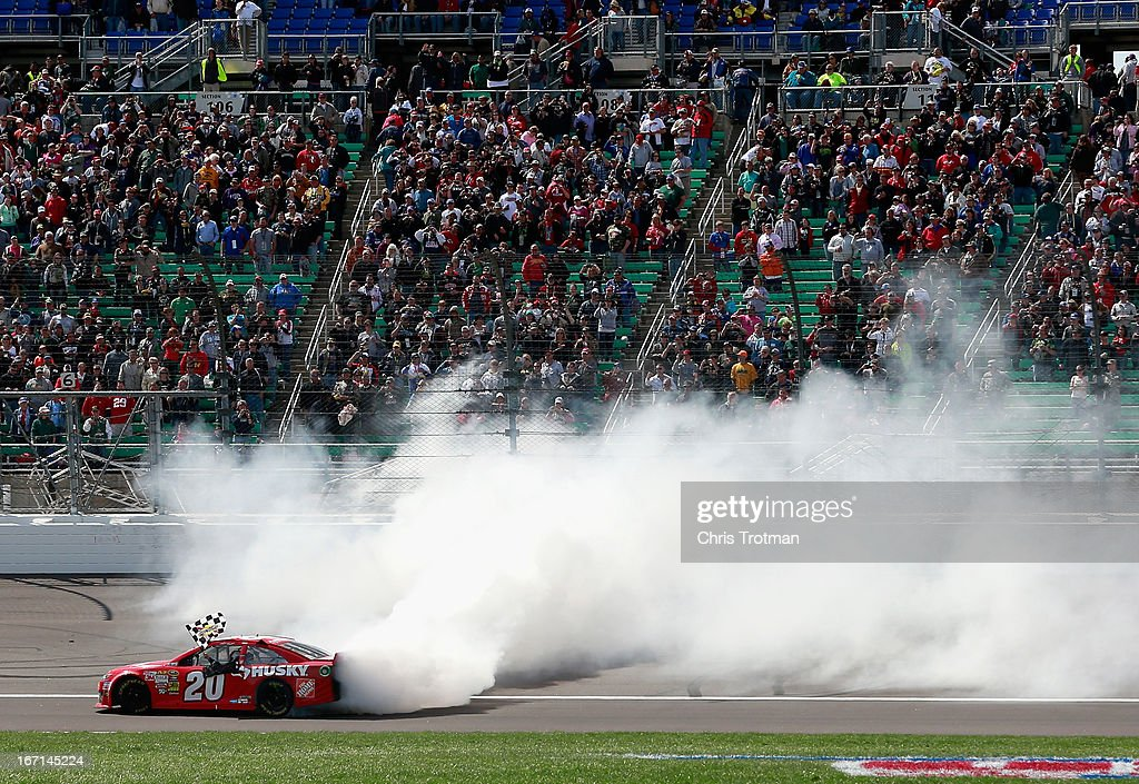Matt Kenseth, driver of the #20 The Home Depot/Husky Toyota, celebrates with a burnout after winning the NASCAR Sprint Cup Series STP 400 at Kansas Speedway on April 21, 2013 in Kansas City, Kansas.