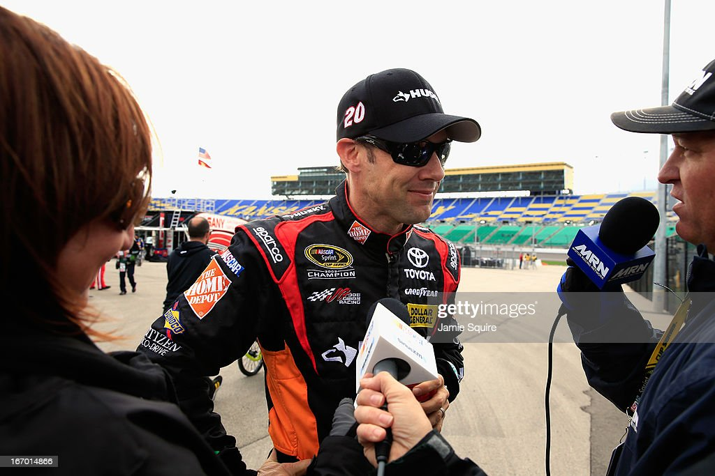 <a gi-track='captionPersonalityLinkClicked' href=/galleries/search?phrase=Matt+Kenseth&family=editorial&specificpeople=204192 ng-click='$event.stopPropagation()'>Matt Kenseth</a>, driver of the #20 The Home Depot/Husky Toyota, is interviewed after qualifying for pole position for the NASCAR Sprint Cup Series STP 400 at Kansas Speedway on April 19, 2013 in Kansas City, Kansas.