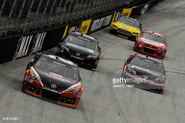 Matt Kenseth driver of the The Home Depot/Husky Toyota leads a group of cars during the NASCAR Sprint Cup Series Food City 500 at Bristol Motor...