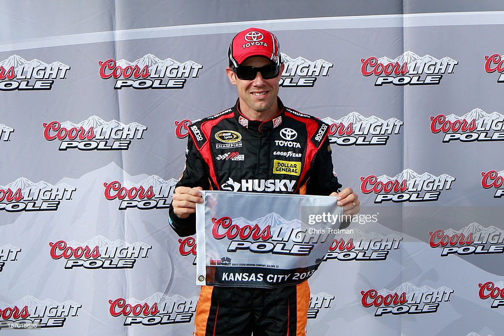Matt Kenseth, driver of the #20 The Home Depot/Husky Toyota, poses with the Coors Light Pole award after qualifying for pole position for the NASCAR Sprint Cup Series STP 400 at Kansas Speedway on April 19, 2013 in Kansas City, Kansas.