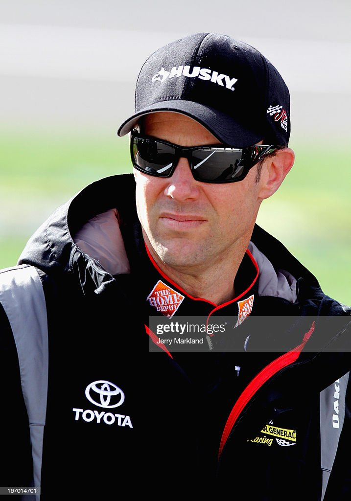 Matt Kenseth, driver of the #20 The Home Depot/Husky Toyota, stands on the grid during qualifying for the NASCAR Sprint Cup Series STP 400 at Kansas Speedway on April 19, 2013 in Kansas City, Kansas.