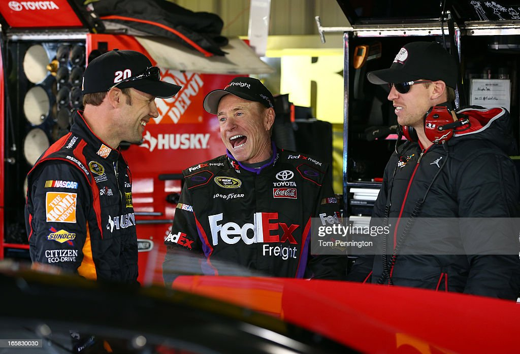 <a gi-track='captionPersonalityLinkClicked' href=/galleries/search?phrase=Matt+Kenseth&family=editorial&specificpeople=204192 ng-click='$event.stopPropagation()'>Matt Kenseth</a>, driver of the #20 The Home Depot/Husky Toyota, talks with <a gi-track='captionPersonalityLinkClicked' href=/galleries/search?phrase=Mark+Martin&family=editorial&specificpeople=204455 ng-click='$event.stopPropagation()'>Mark Martin</a>, driver of the #11 FedEx Freight Toyota, and driver <a gi-track='captionPersonalityLinkClicked' href=/galleries/search?phrase=Denny+Hamlin&family=editorial&specificpeople=504674 ng-click='$event.stopPropagation()'>Denny Hamlin</a> during practice for the NASCAR Sprint Cup Series STP Gas Booster 500 on April 6, 2013 at Martinsville Speedway in Ridgeway, Virginia.