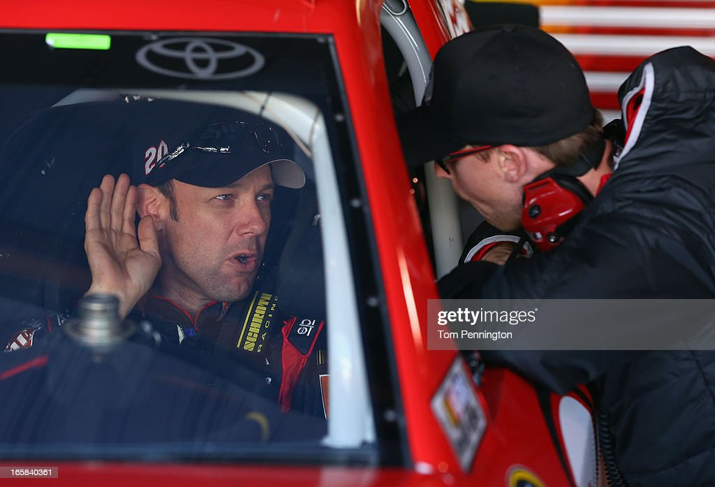 Matt Kenseth, driver of the #20 The Home Depot/Husky Toyota, talks with driver Denny Hamlin during practice for the NASCAR Sprint Cup Series STP Gas Booster 500 on April 6, 2013 at Martinsville Speedway in Ridgeway, Virginia.