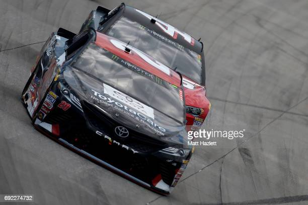 Matt Kenseth driver of the ToyotaCare Toyota leads Kurt Busch driver of the Haas Automation/Monster Energy Ford during the Monster Energy NASCAR Cup...