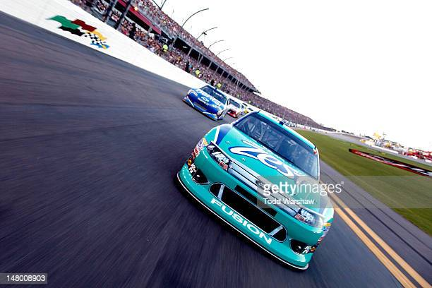 Matt Kenseth driver of the Zest Ford and Ryan Newman driver of the Aspen Dental Chevrolet lead the field during the pace laps prior to the start of...