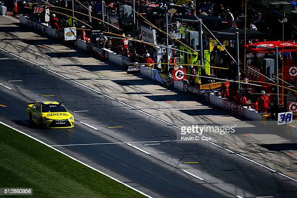 Matt Kenseth drives the Dollar General Toyota down pit road after NASCAR officials handed down a pass through penalty for an infraction on the...